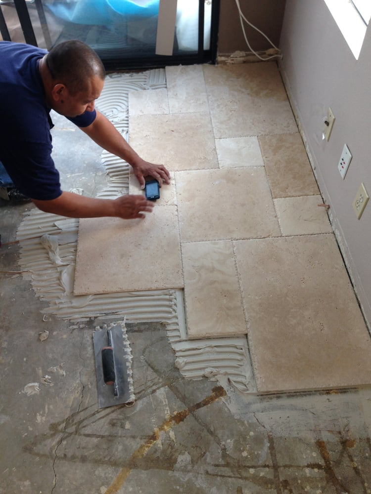 Laying Tile One Slab At A Time Tile Installers Working