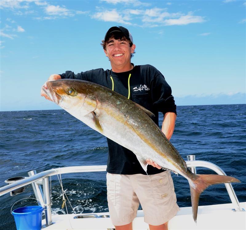 Teenager catching big amberjack yelp for Orange beach fishing report