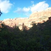 'Photo of Boynton Canyon Trail - Sedona, AZ, United States. View of the mountains' from the web at 'https://s3-media1.fl.yelpcdn.com/bphoto/EE5wdEPC00MRg9vFOT2j-A/168s.jpg'