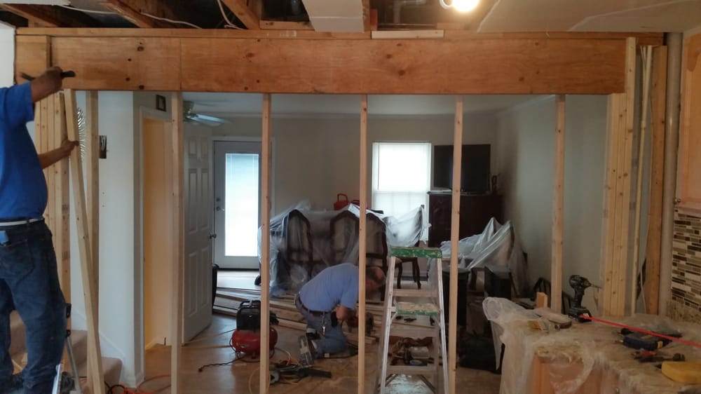 Load bearing wall we took out of a townhouse for a more for Can a load bearing wall be removed