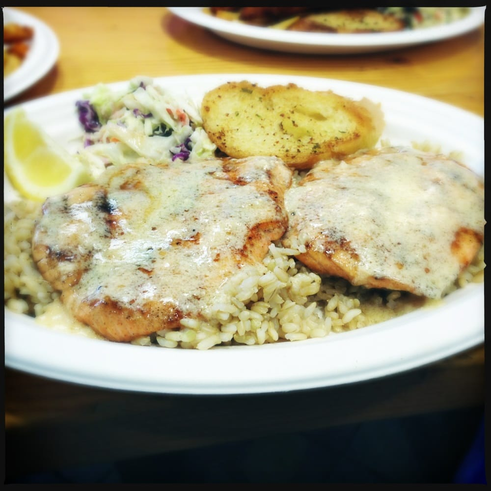 Charbroiled salmon with garlic butter sauce and brown rice for Fish dish burbank