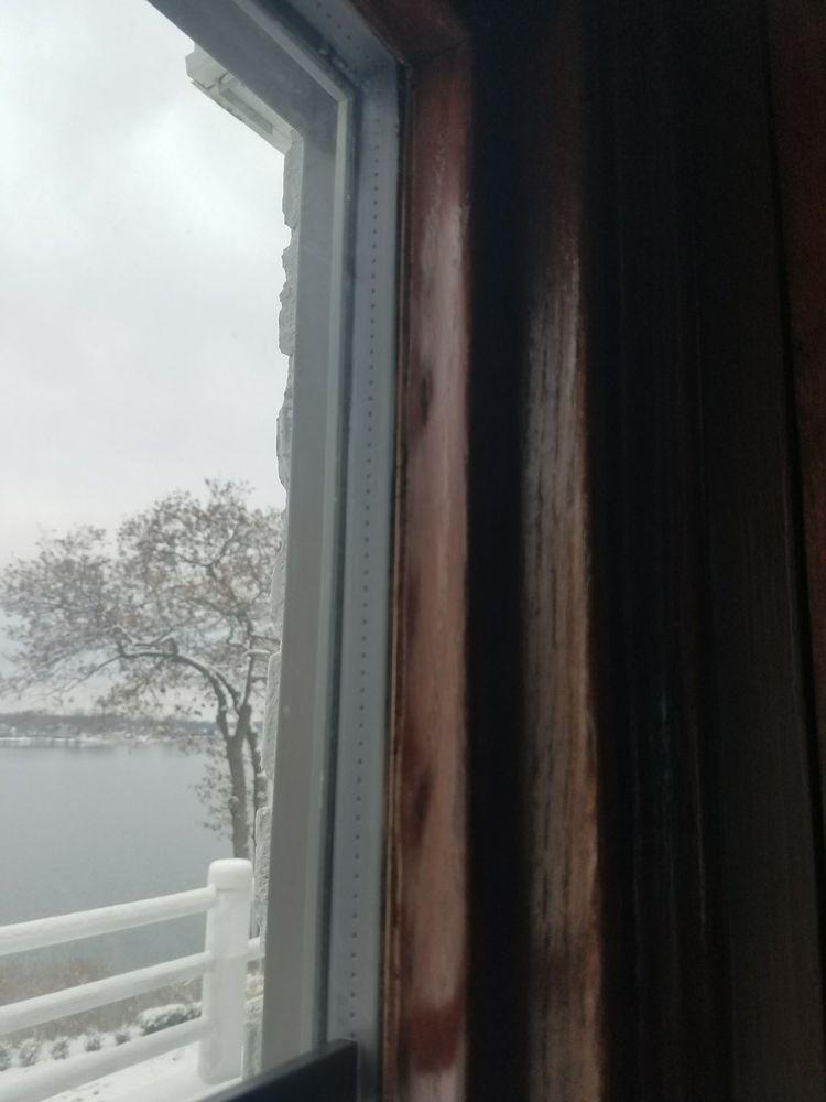 Leaking windows, cracked fiberglass frame, warped & bubbled veneer ...