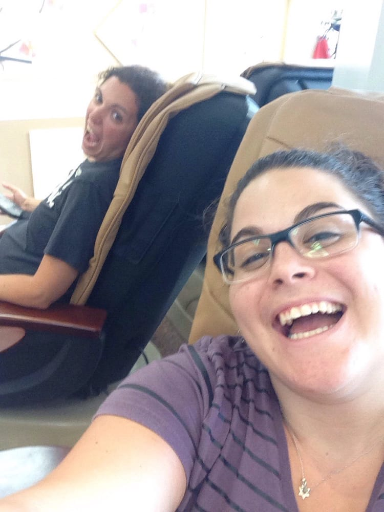 Enjoying the massage chair while getting pedicures. Yay - Yelp