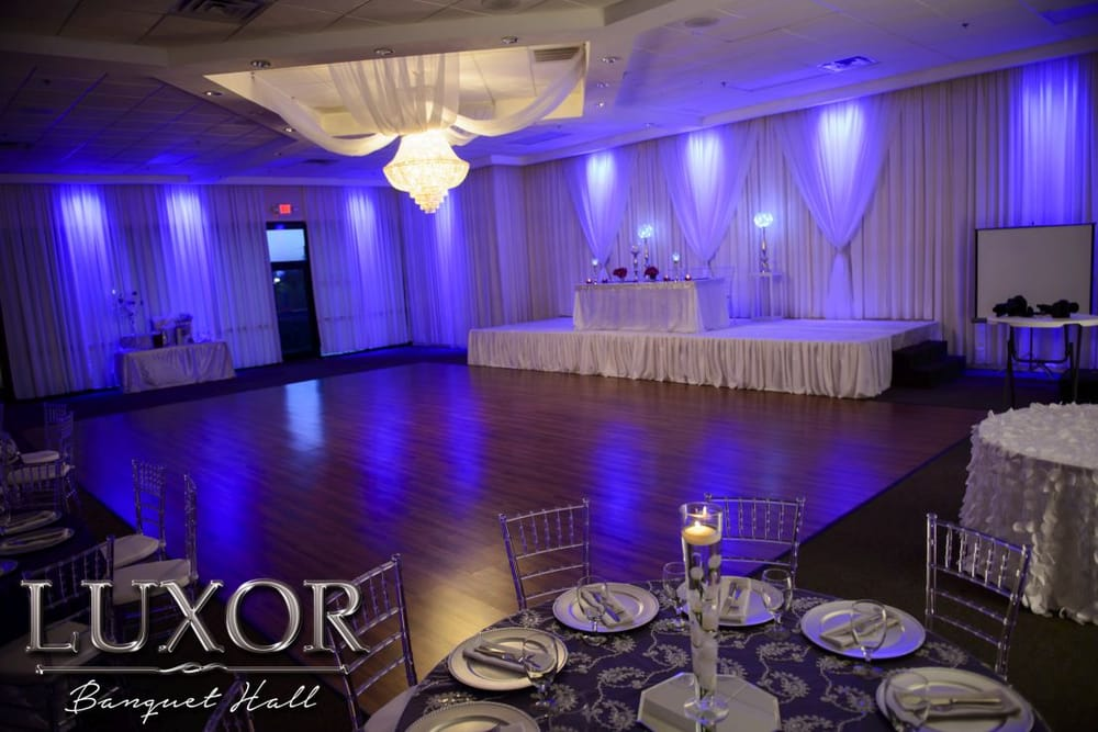 Large Dance Floor Stage With Drapery And Uplighting At