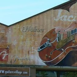 Guitare village musikinstrumenter musikl rere 161 for Domont val d oise