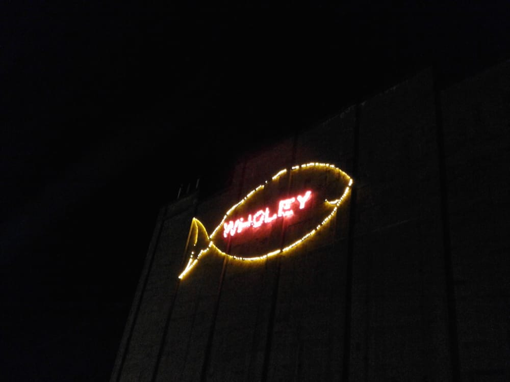 Wholey 39 s gigantic neon fish floats freely and happily in for Wholey s fish market