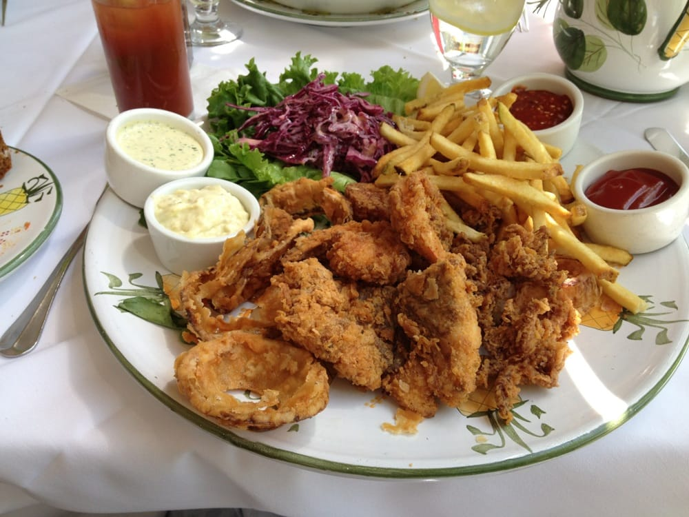 Their version of fish and chips! Fish, shrimp, calamari, scallops, fries and onions rings with 3 ...