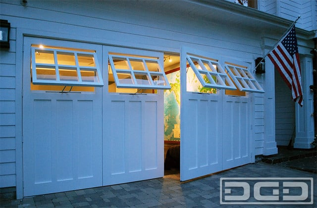 real swing out carriage garage doors with functional awning