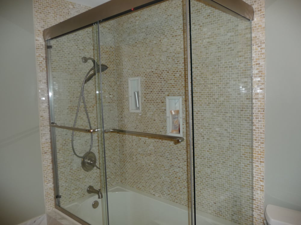onyx tiles walls ,marble tiles niche and frame less shower door ...