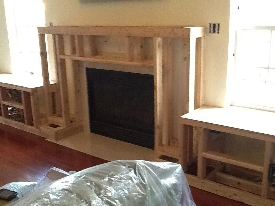 Framing to the new contemporary fireplace surround - Yelp