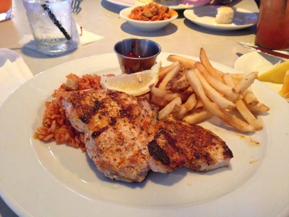 ... Blackened Swordfish with fries and charleston rice!!! Absolutely