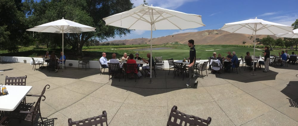outdoor dining on the patio next to the 18th green Yelp