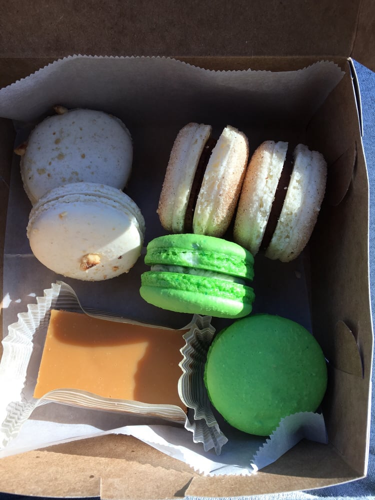 Photo of Amelie's French Bakery - Atlanta, GA, United States. The pistachio (green) were fresh. The others were too dense for my liking.