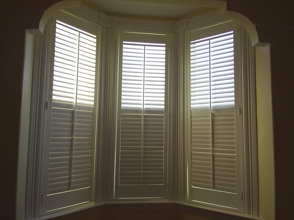 Bay Window Shutters With Dividing Mid Rail Allows