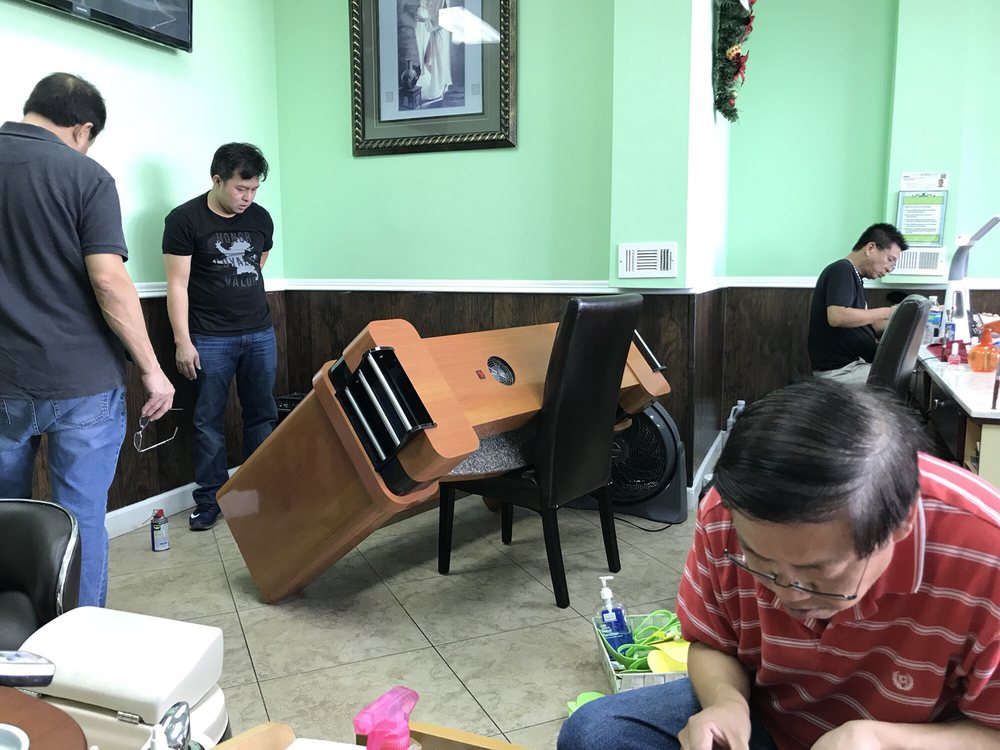 This is an all male nail technician salon! This could be an album ...