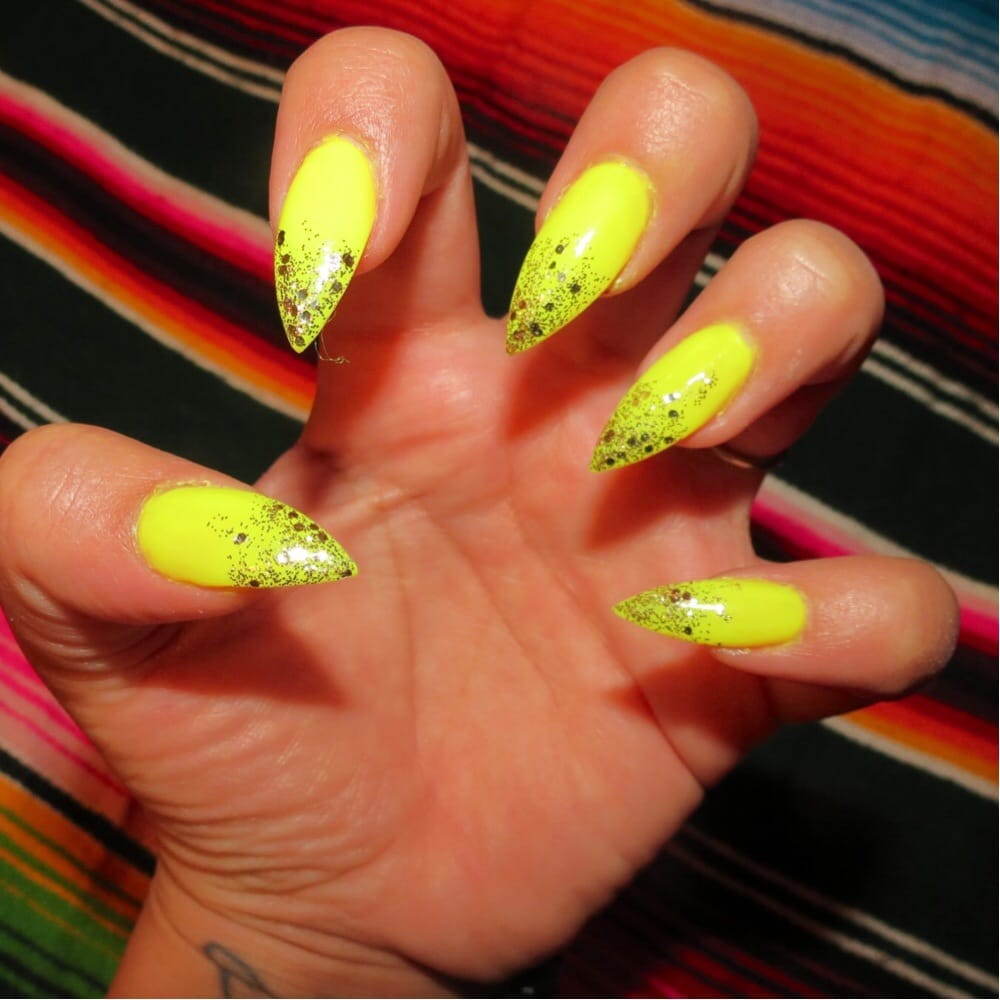 Acrylic neon stiletto nails with gradient glitter. Done by Van - Yelp