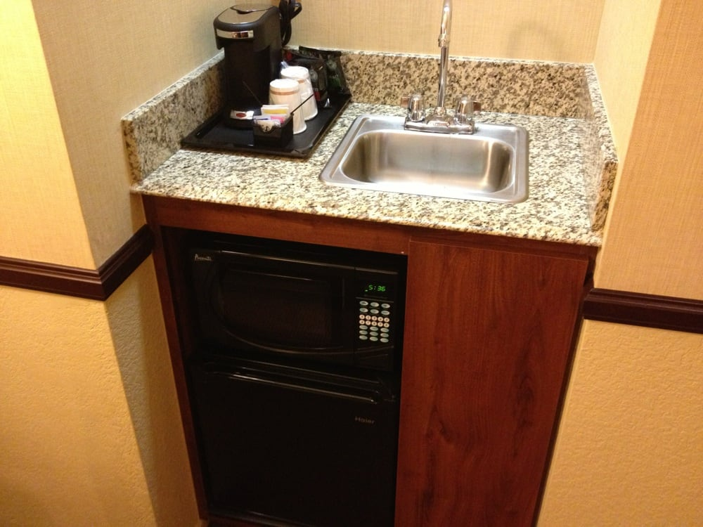 Typical coffe maker, microwave and small reefer. Wet bar ...