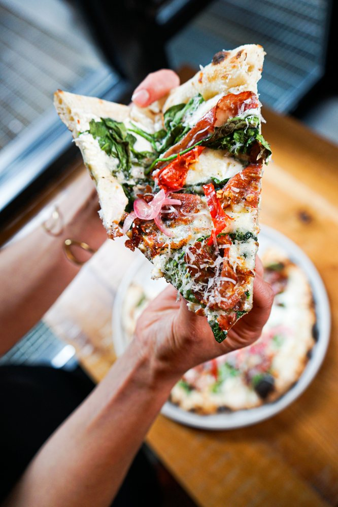 Coppa + Spinach Pizza with spicy coppa, pickled onions, and