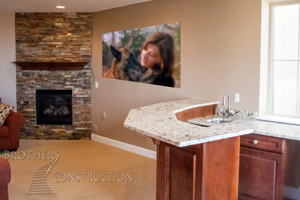 Basement Corner Fireplace And Custom Wet Bar By Brothers