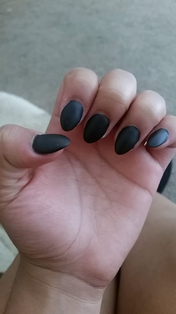 Matte black almond shaped acrylics. Most of the little imperfections ...