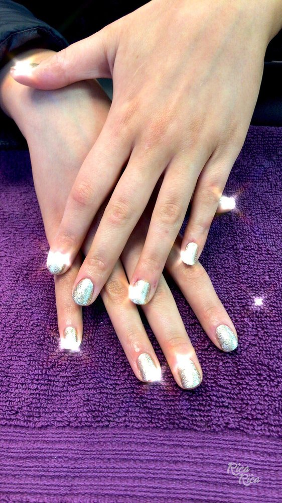Very beautiful and festive manicure . Come in and relax with us ...