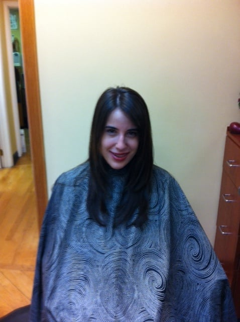 Credits stylist dawn model has a long layered haircut for A total new you salon