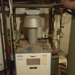 old boiler being replace with a crown boiler installation. Black Bedroom Furniture Sets. Home Design Ideas