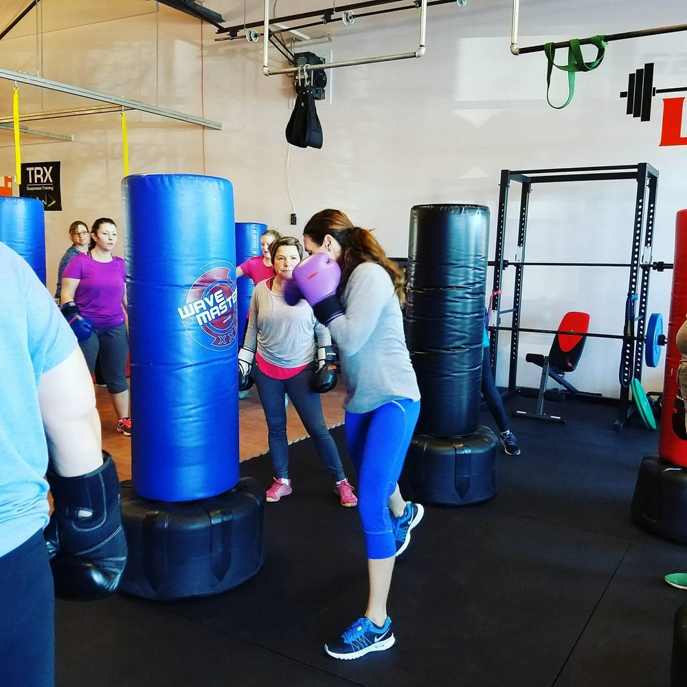Highlands Ranch Co United States Pictures And Videos And: Sonja Steward, Owner Teaching New Clients Boxing Skills