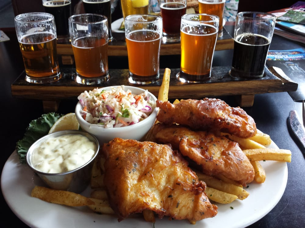 Fish and chips with a paddle (stave) of beer. - Yelp