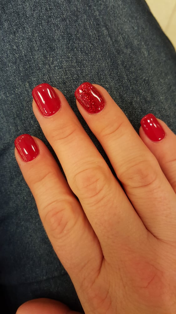 Sparkly holiday nails. Red no chip with red glitter accent nail - Yelp
