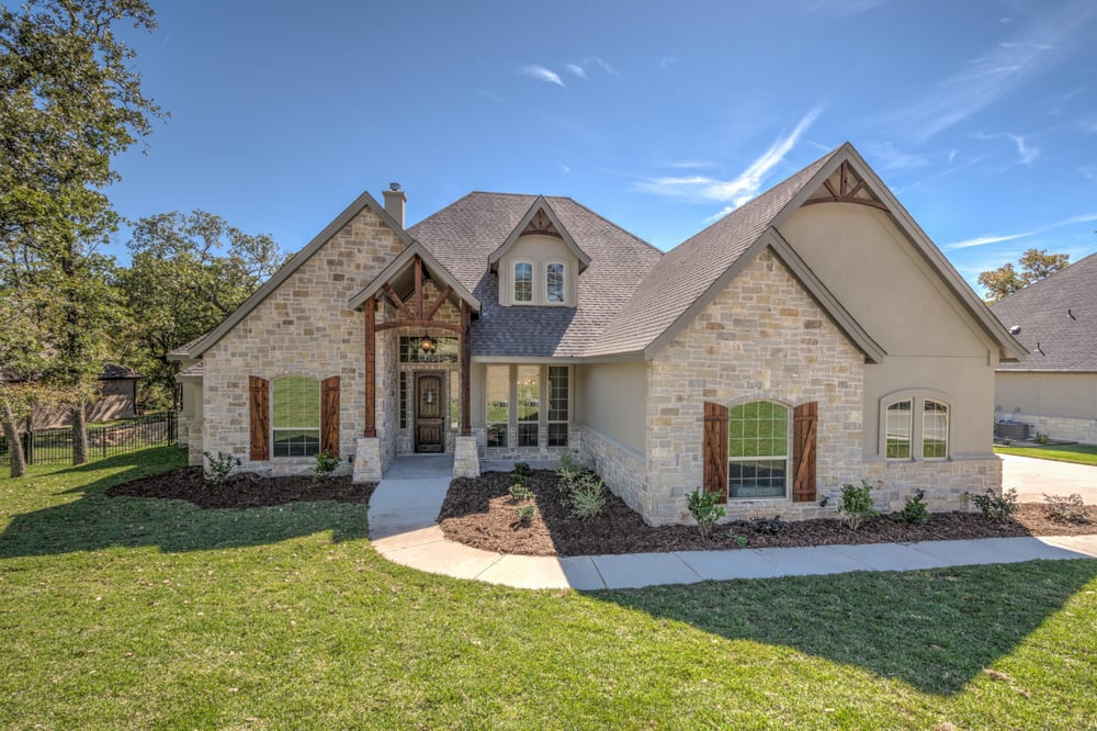 Stone and stucco exterior with stained cedar accents yelp for Stucco homes with stone accents