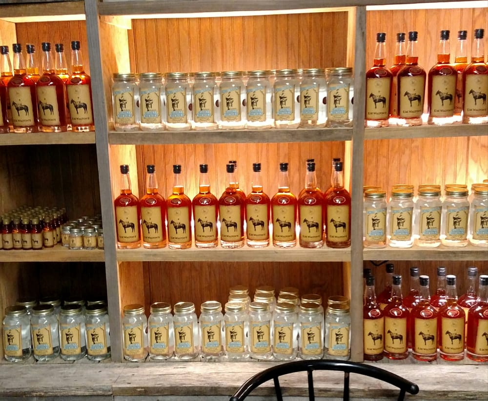 Our display of our e m walton 39 s corn whiskey and for Triangle motor inn jacksonville nc