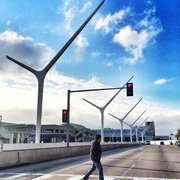 'Photo of Los Angeles International Airport - LAX - Los Angeles, CA, United States. LAX' from the web at 'https://s3-media1.fl.yelpcdn.com/bphoto/KPRz85wJbbFSuzdX2BTvTA/180s.jpg'
