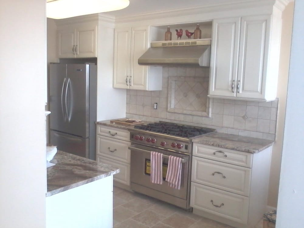 After photo of kitchen demo picture, Wolf range, hood, tile ...