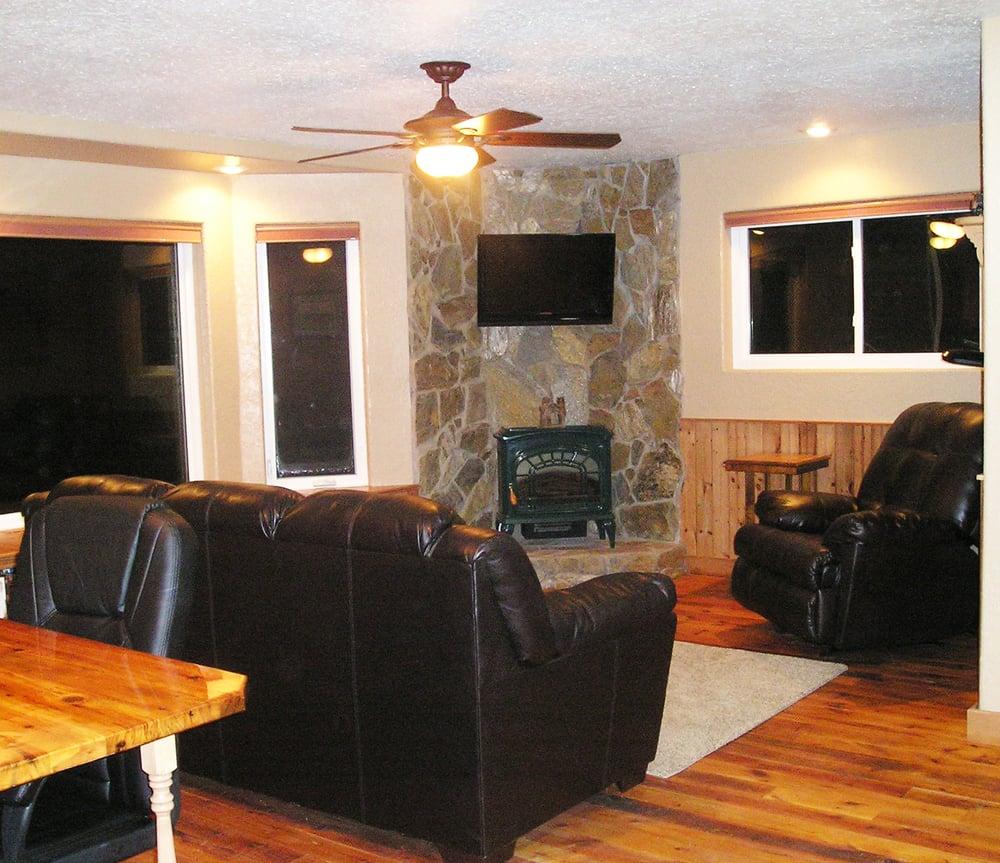 Living Room Features Bay Window Reclaimed Wood Floor