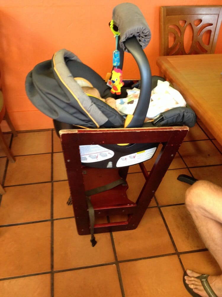 Check out this upside down high chair they set up for our baby car ...