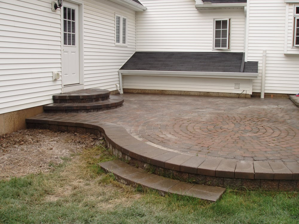 Unilock Patio Repair With New Half Moon Stairs Off Entry