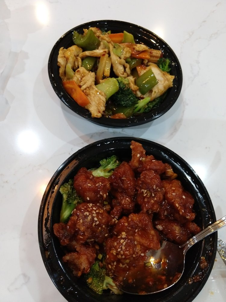 Hunan chicken and Sesame chicken (picture taken after I put food on