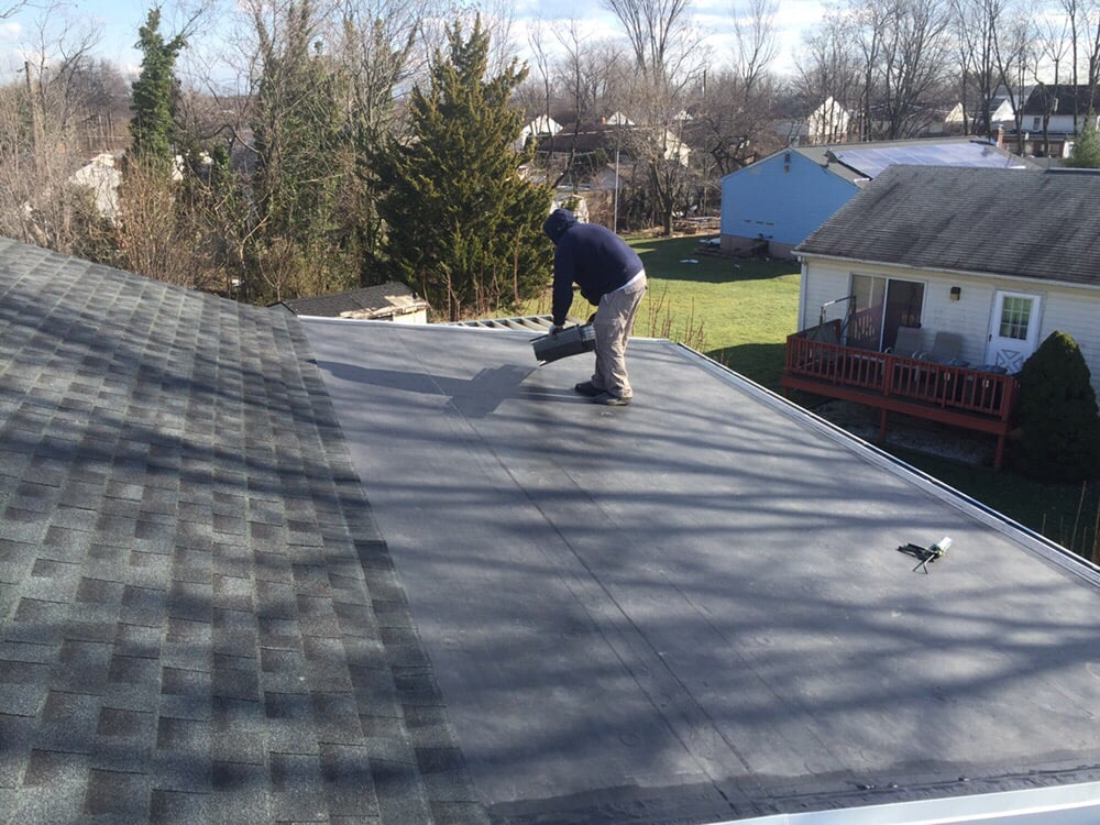 A Small Epdm Roof Flat Roof With An Asphalt Shingle