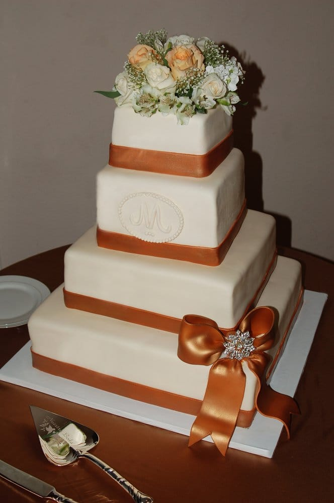 wedding cakes in san diego white amp bronze wedding cake with monogram amp rhinestone bow 24775