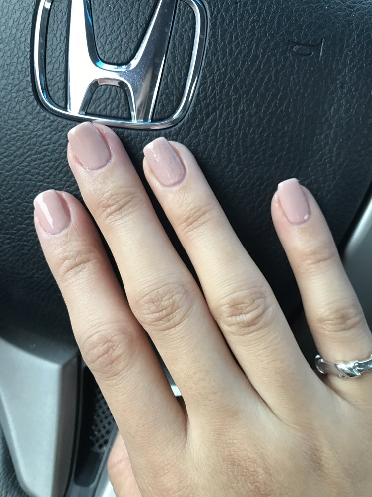 She filed my natural nails to have that coffin shape that acrylics ...