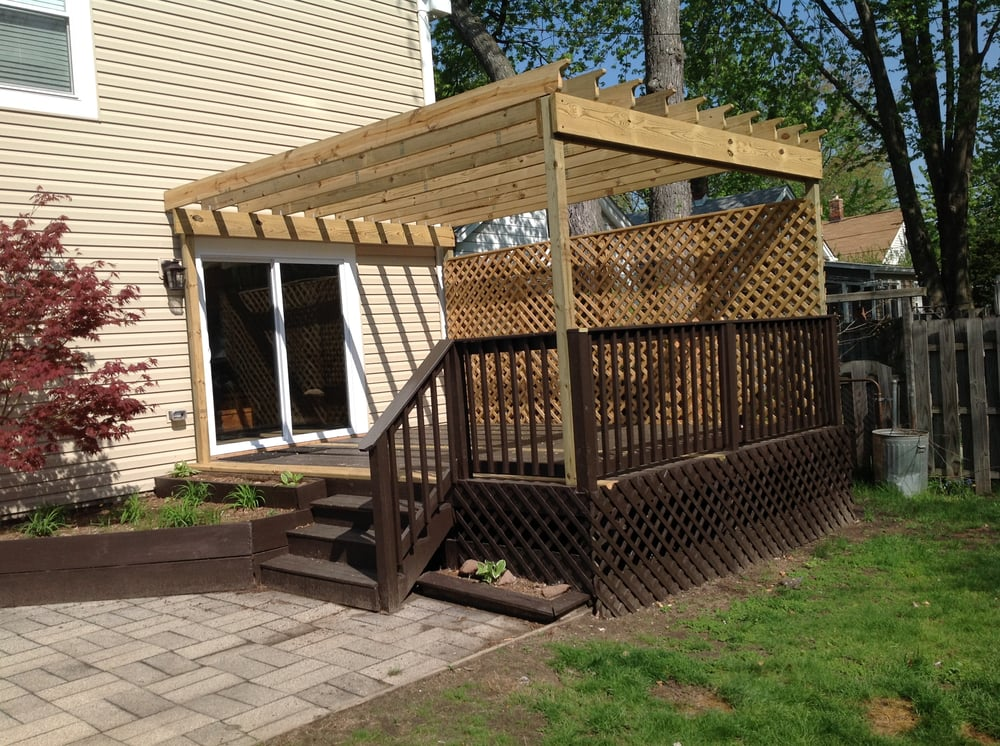 A Pressure Treated Wood Pergola Added To A Existing Deck