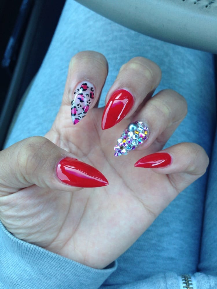 Red nails, cheetah print and Swarovski crystals... Done by: Aaron ...