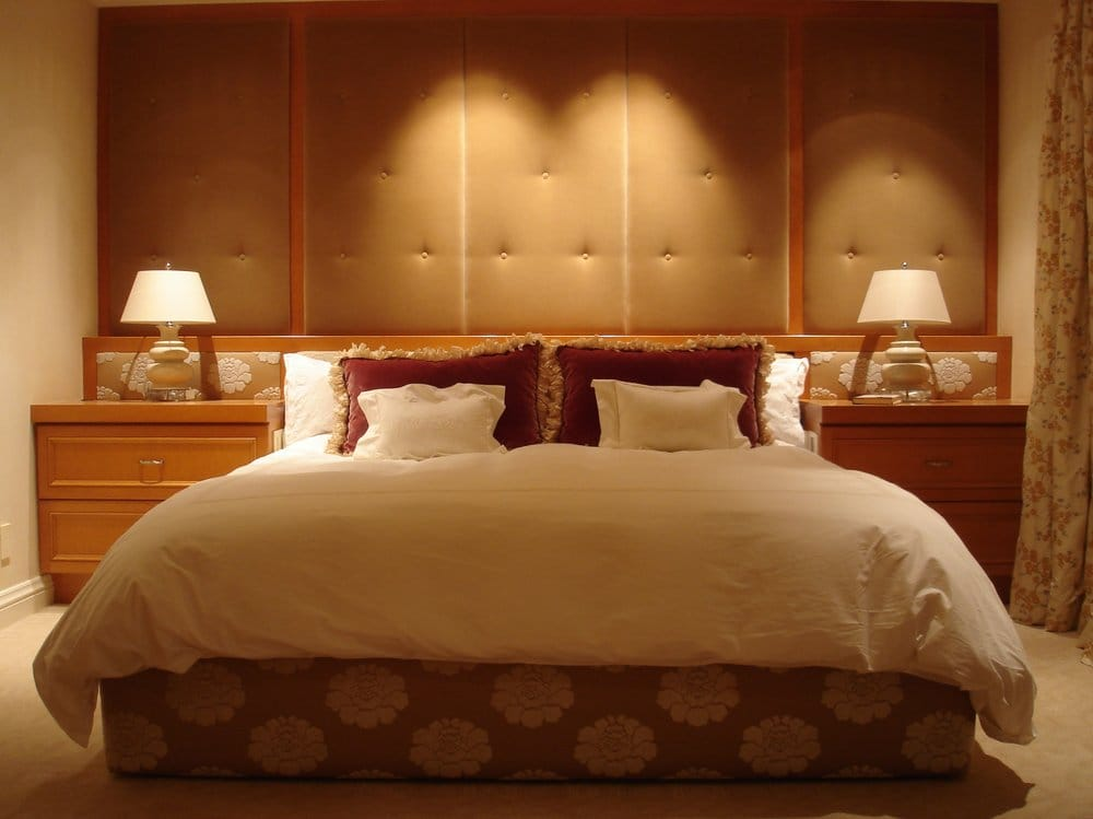 Bedroom With Upholstered Wall Panels And Bed Frame Wright