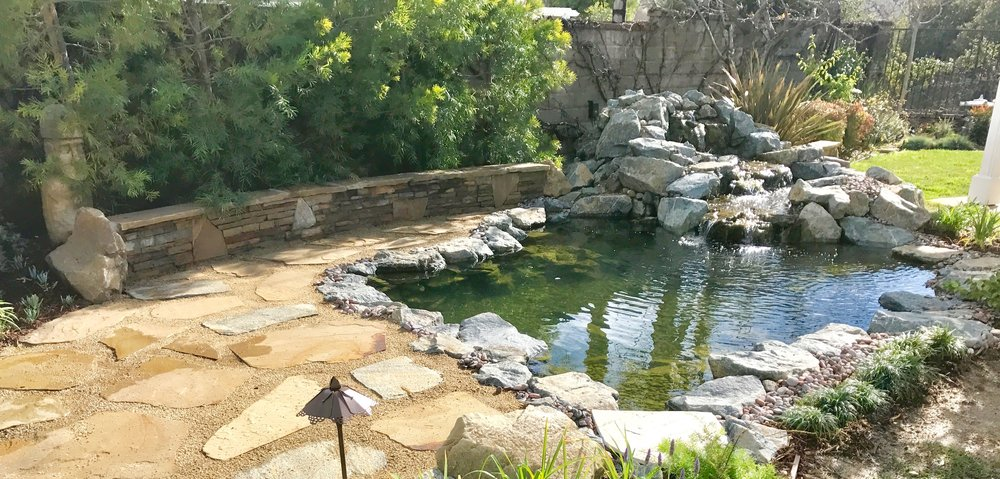 Pond with flagstone trim and planter walls yelp for Pond companies near me
