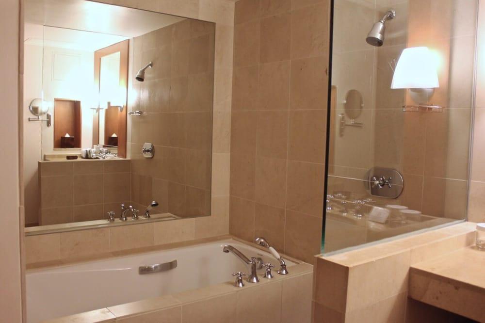 Bathroom Fixtures San Francisco limestone bathroom with separate tub & shower. high grade bathroom