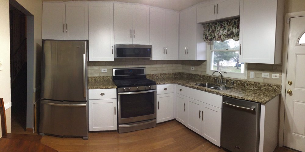 Photo of Custom Wood Cabinet Refacing - Lansing, IL, United States. Refaced 1970s