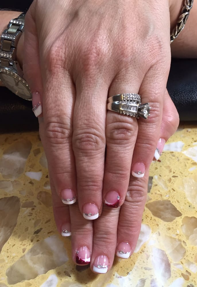 My festive classy gel nails, courtesy of Vivi!! Love them! - Yelp