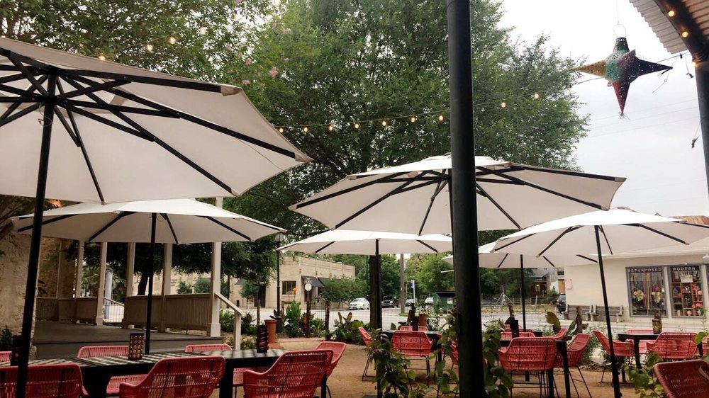 Awesome Patio With Overhead Covering Or Umbrellas Giving