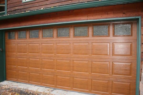 Door tech llc get quote building supplies 5768 e for Steel garage doors that look like wood
